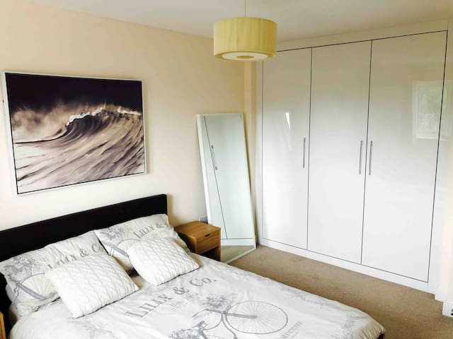 Large mirror and wardrobe space