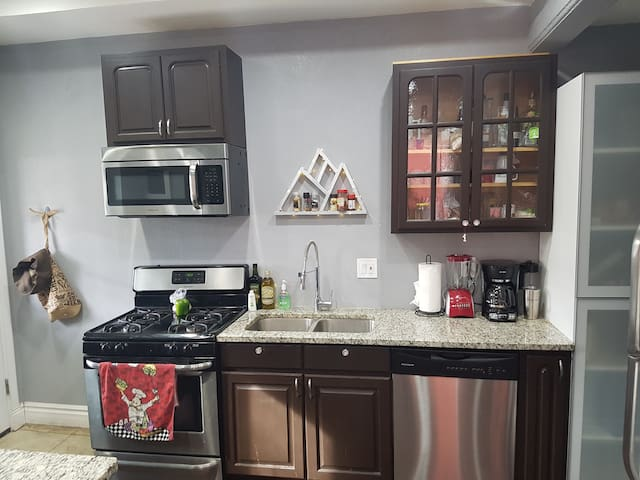 Spacious kitchen with beautiful granite counter tops.   Cook, or enjoy complimentary coffee.