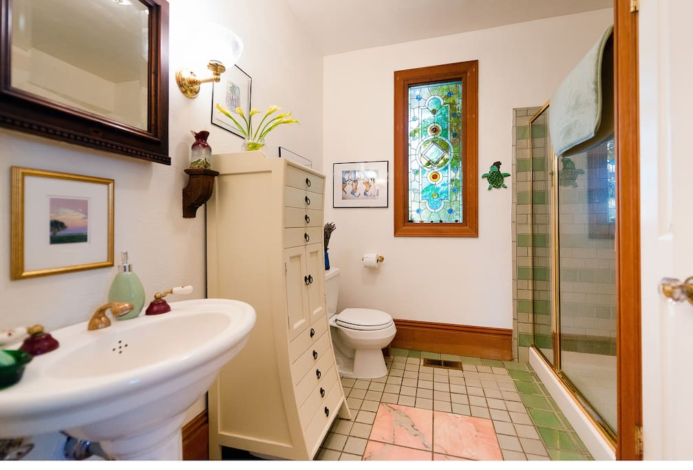 Your bathroom, with a stained glass window from the 1850's.