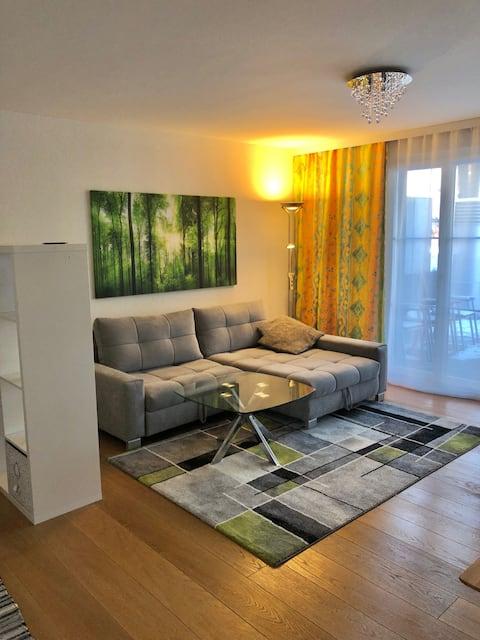 Gemütliche 2 Zimmer Wohnung mit Gartensitzplatz