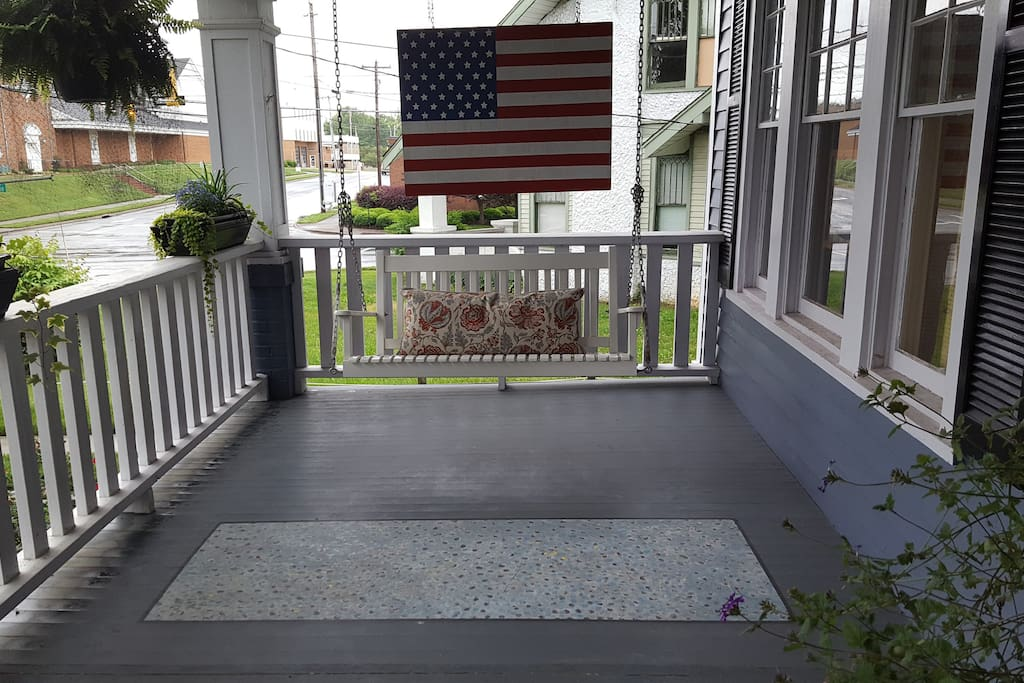Front porch swing with handmade flag