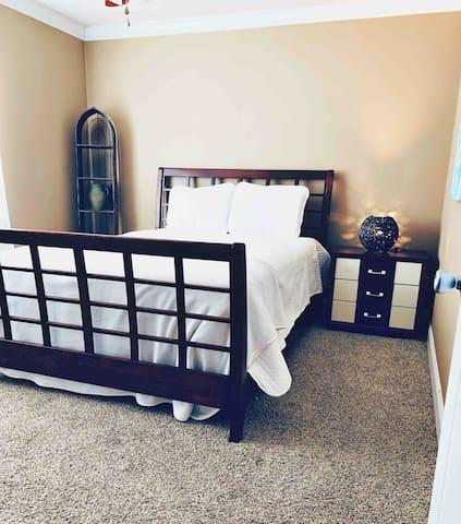 Bedroom 2. Also has big flat screen tv.