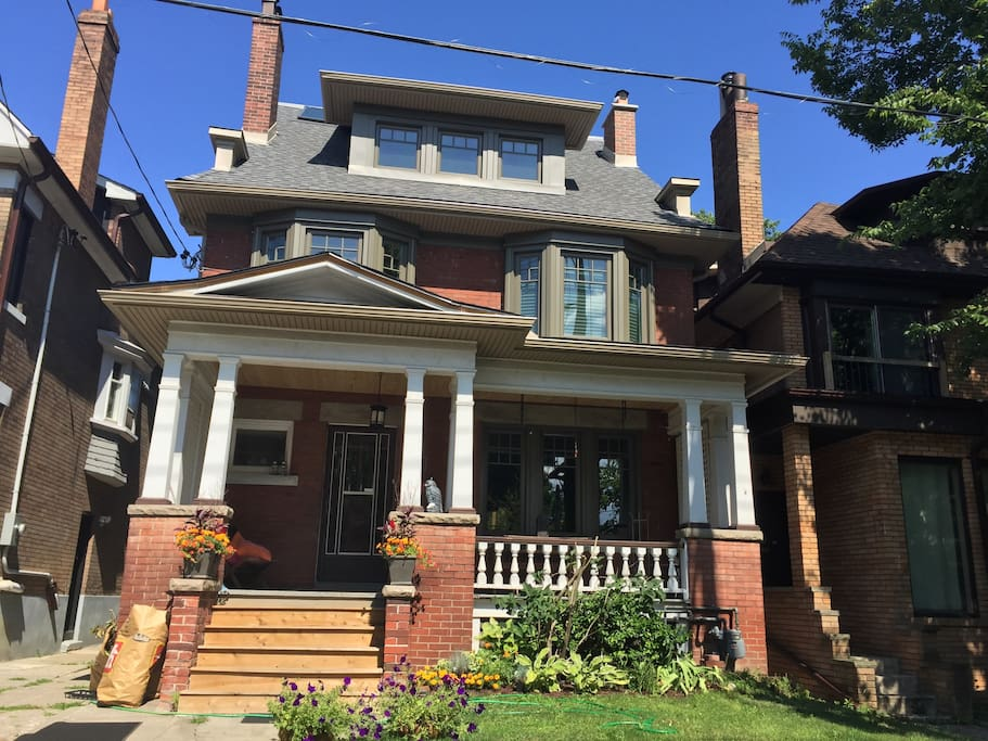 Century old High Park home features a large front porch