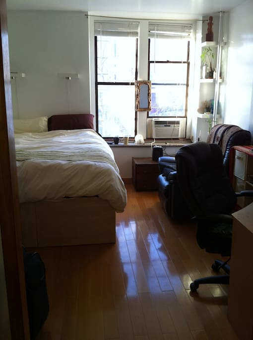 Large bedroom with huge sunny windows and desk/chair. (this is my bed) iMac available for your use!