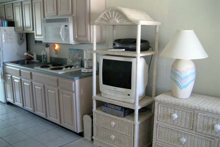 Kitchen and living area tv