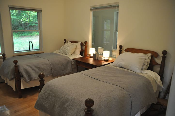 The third bedroom, on the ground floor, has two twin antique beds and a beautiful maple antique dresser.