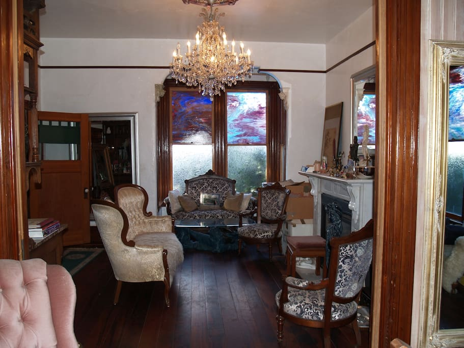 The livingroom. Complete with antique furniture and working fireplace.