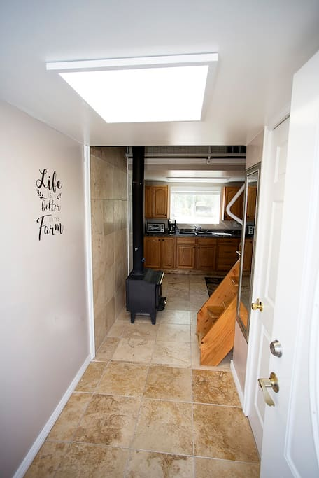 You first walk into a spacious entryway.