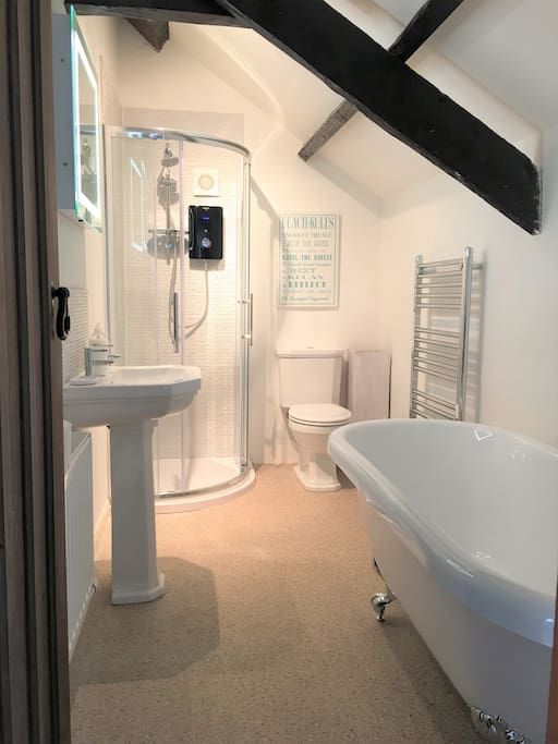 New bathroom with free-standing roll- top bath and separate power shower