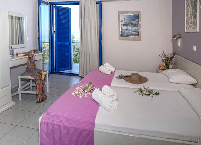 Bedroom with two single beds.All rooms have a small fully equipped kitchen and fridge.