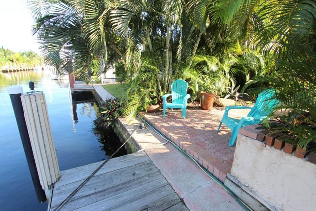 Watch boats on the canal or iguanas sunning on the dock