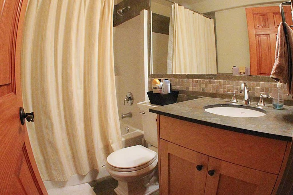 Bathroom with blow dryer and toiletries.