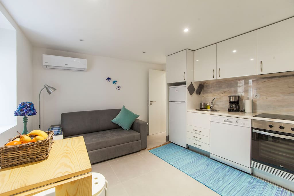 ground floor , open space kitchen with dining table up to 4 people and sofa-bed