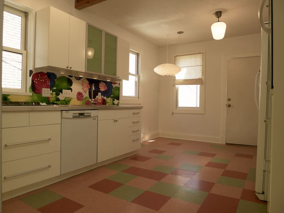 Full-size kitchen with gas cook top, dish washer, oven and breakfast nook.