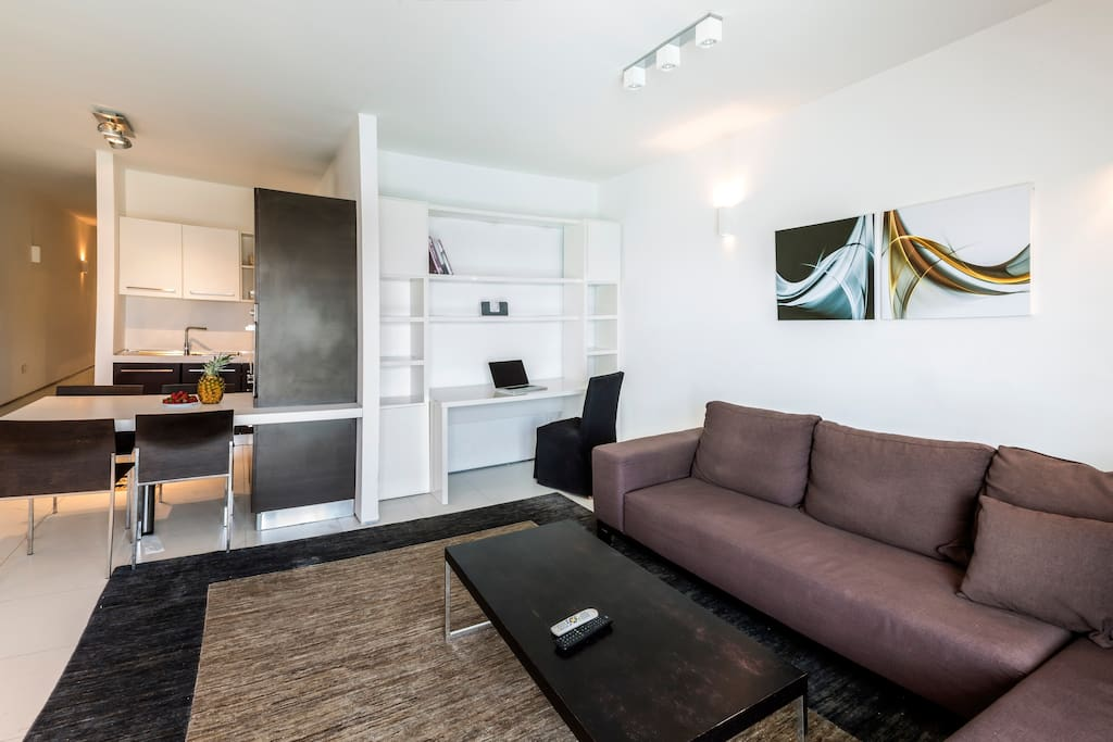 TheThe spacious open-plan living, dining and kitchen area with a working station