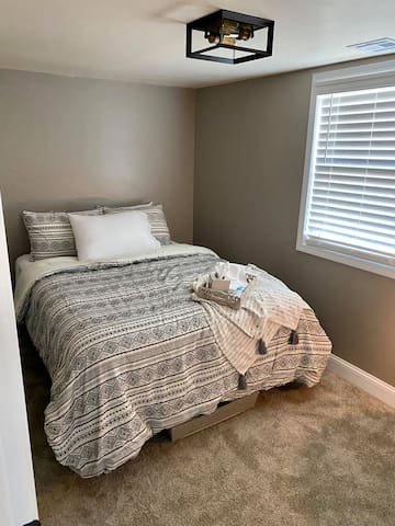 Queen room-amenities include-extra pillows, throw blanket, alarm clock, lamp with USB ports extra bedding