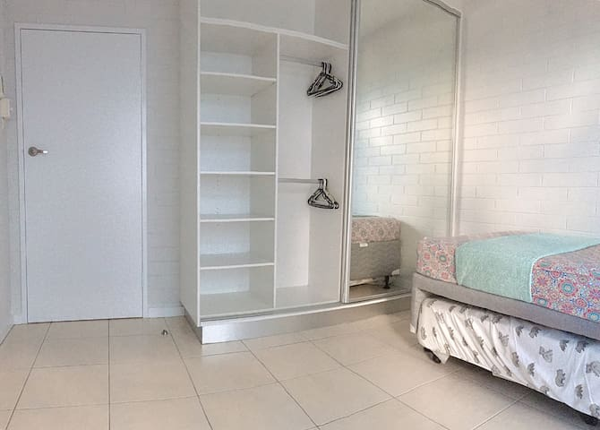 Room is equipped by a new large wardrobe and mirror