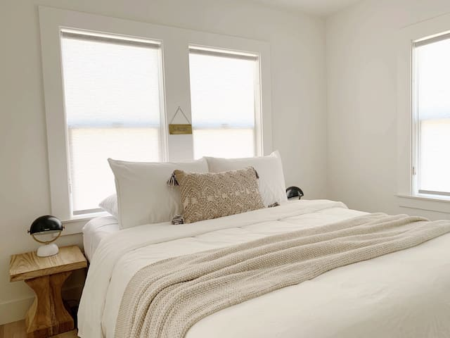 Nama-stay in this bedroom to unwind. The calm color palette, plush memory foam mattress, and soft cotton linens are made for relaxing.