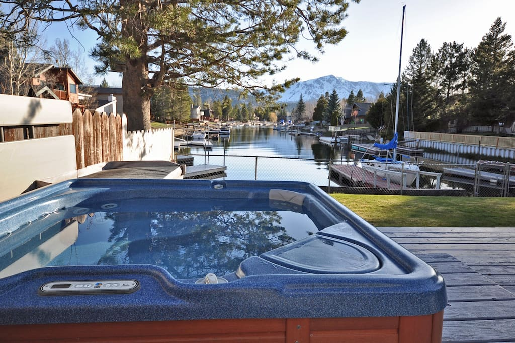 Take a dip in the hot tub on the back deck overlooking Mt. Tallac