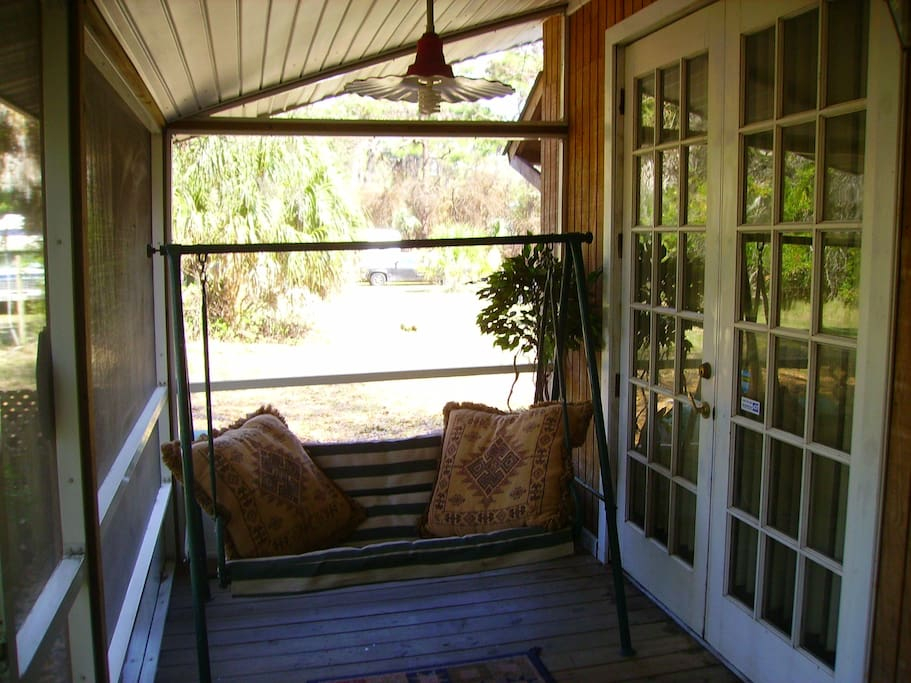 The sceened in porch has it's own swing and french door off the bedroom