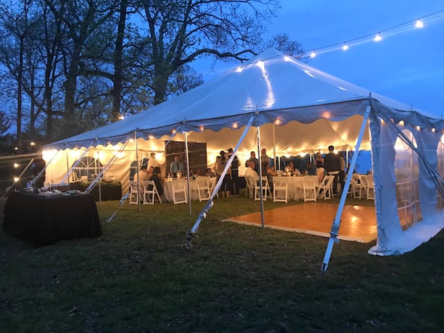 For this wedding reception, this 40'x40' tent with dance floor is positioned with an excellent view of the historic Potomac River.