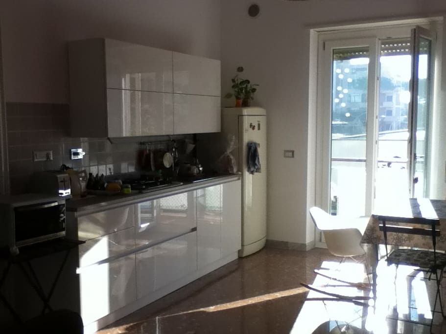 Sunny kitchen/open living room with cozy balcony