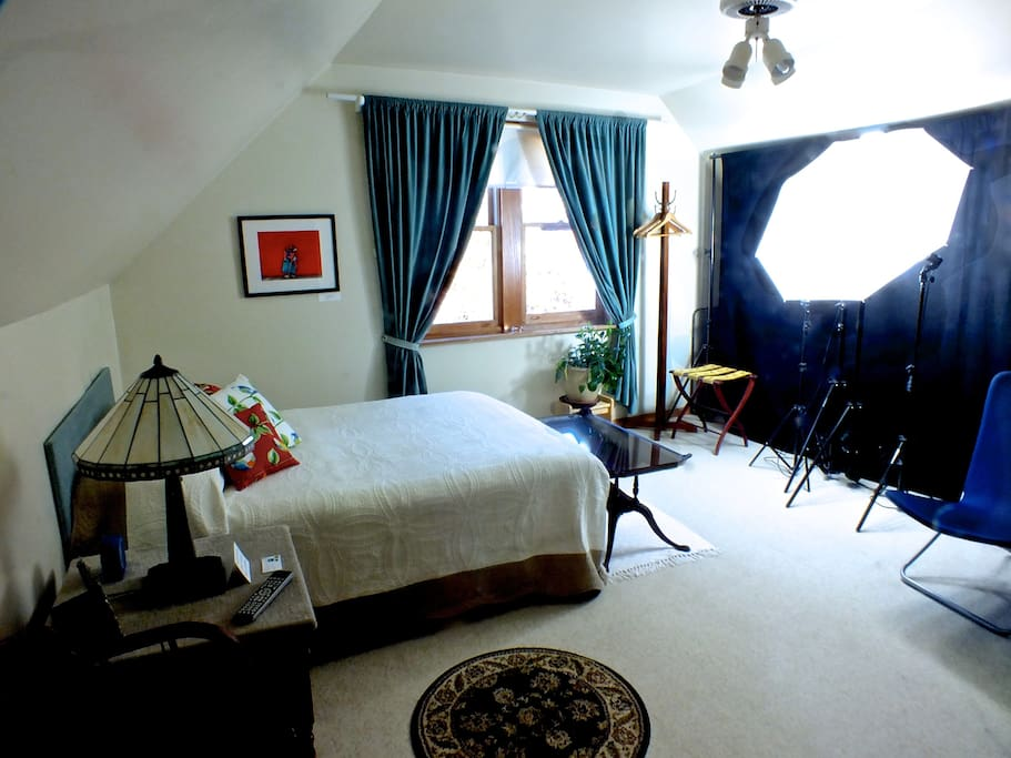 The spacious bedroom and sitting area (~10' X 20') with window facing east and overlooking Avers Avenue