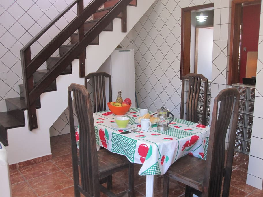 Kitchen with stairs up to terrace