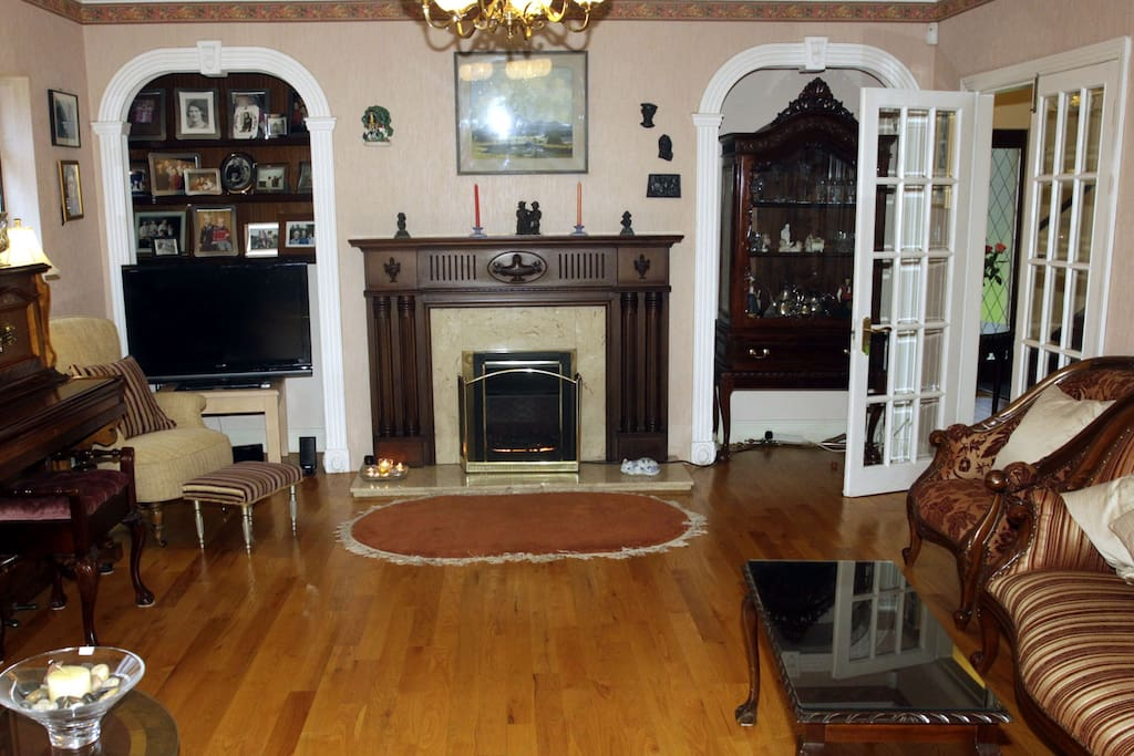 Main Sitting Room with Open Fireplace and Traditional Irish feel