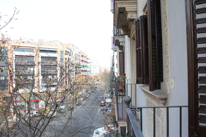 A Double room with private balcony one street from amazing Sagrada Familia.