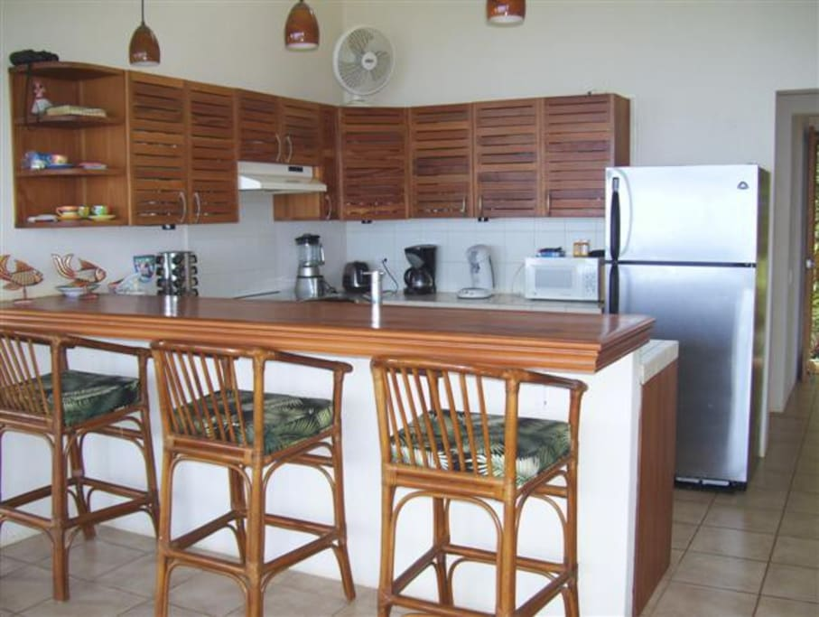 Large Kitchen , Wood Cabinets , Bar Stool Seating