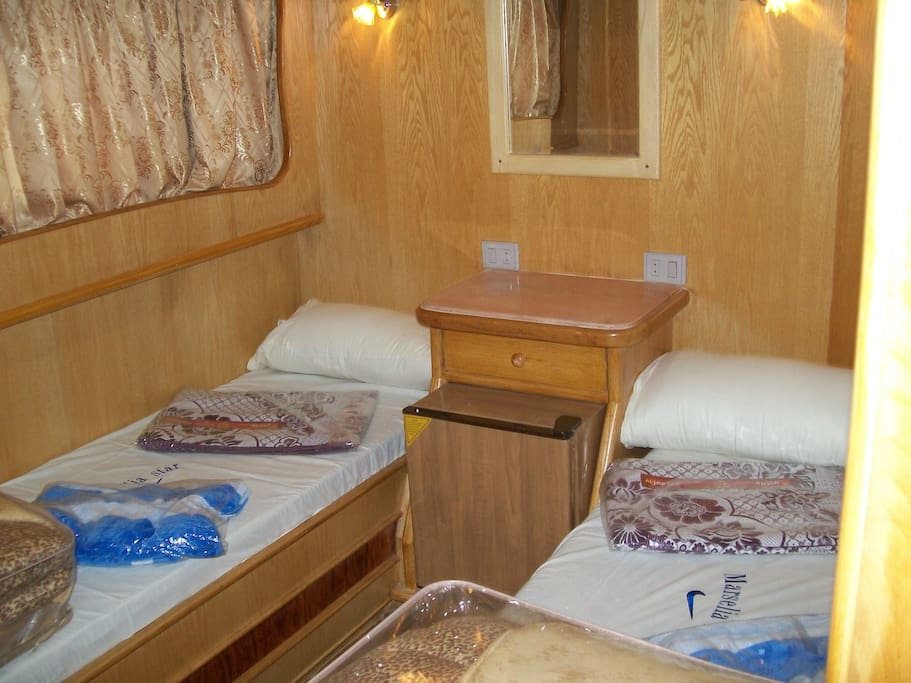 Comfortable air-conditioned double room including breakfast, lunch and dinner. 2 Beds