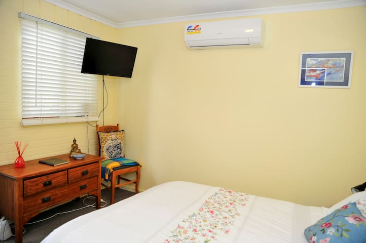 The bedroom features reverse-cycle heating and cooling and a TV.