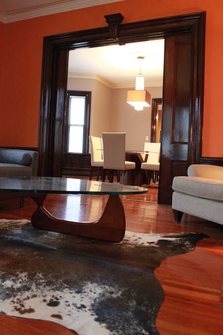 Brazilian cowhide rug (super soft!) and designer coffee table in the living room