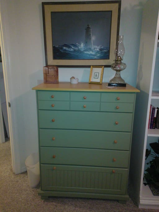 Dresser with extra pillow and blankets