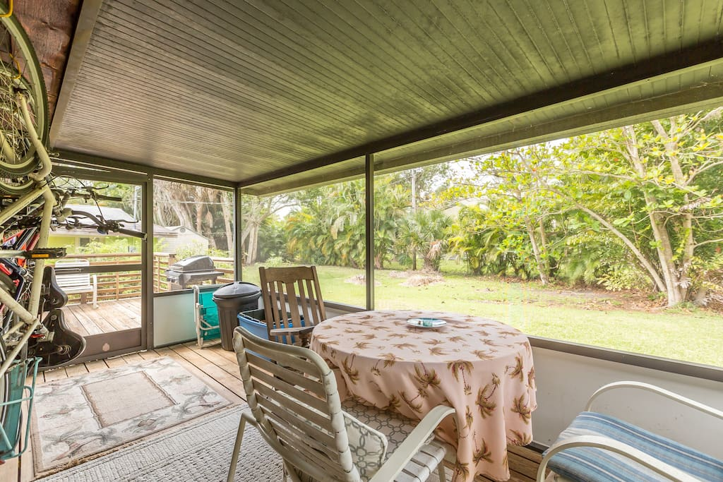 Step out to the screened patio and see the verdant beauty of the private backyard.