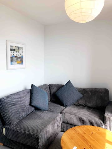 This is the sitting room which comes with the booking. It boasts a comfy corner sofa, coffee table and TV. There are also some information about the area in this room too.