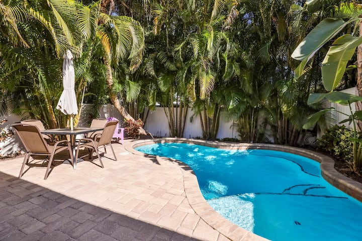 Groovy Guava ~ Private pool with GOLF Cart and 1/2 Block to Beach