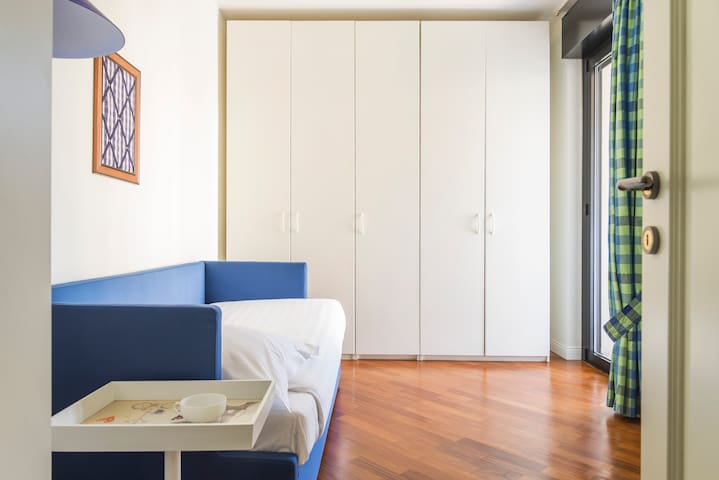 SECOND BEDROOM WITH SINGLE BED AND ONE OTHER PUSH-UP SINGLE BED.