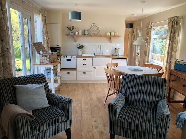Kitchen area with patio doors onto the decking
