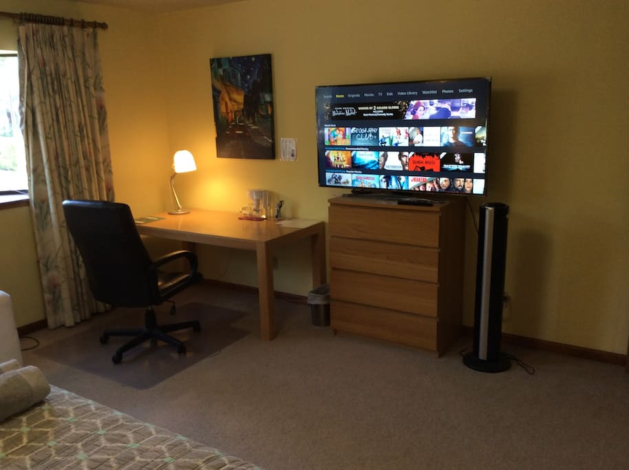 "Need to work and relax? No problem, a desk and a brand new 55"" UHD TV with Amazon Prime, Netflix, HBO Go are included."