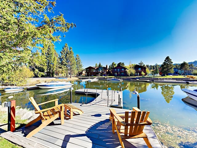This alpine lake house boasts a private boat dock.