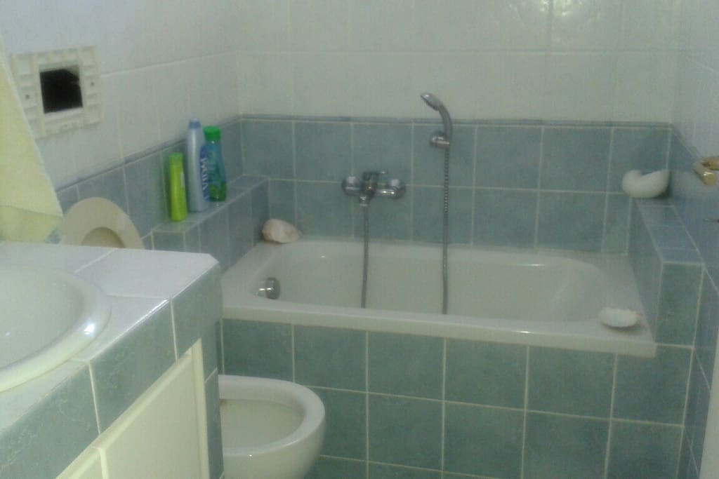 One of the 2 bathrooms with a bathtub