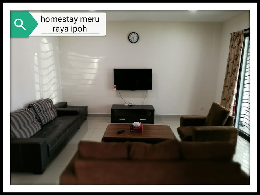 spacious living room with 2 types of sofa,aircond,large HD tv with astro