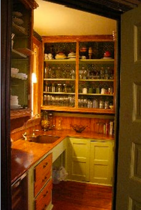 Butler's Pantry - old world detail, fully stocked with china and glassware, a wine cooler and a copper sink!