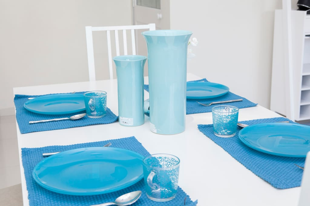 Dining table with an attractive blue and white crockery set.