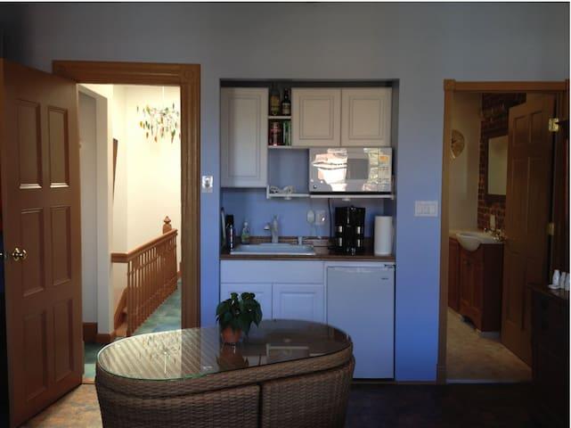 Studio kitchenette with doors to hall and bathroom