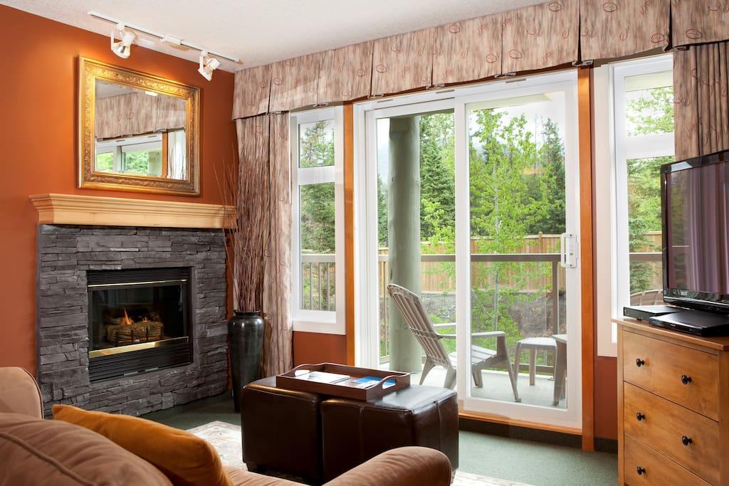 Warm, inviting fireplace and access to terrific deck area