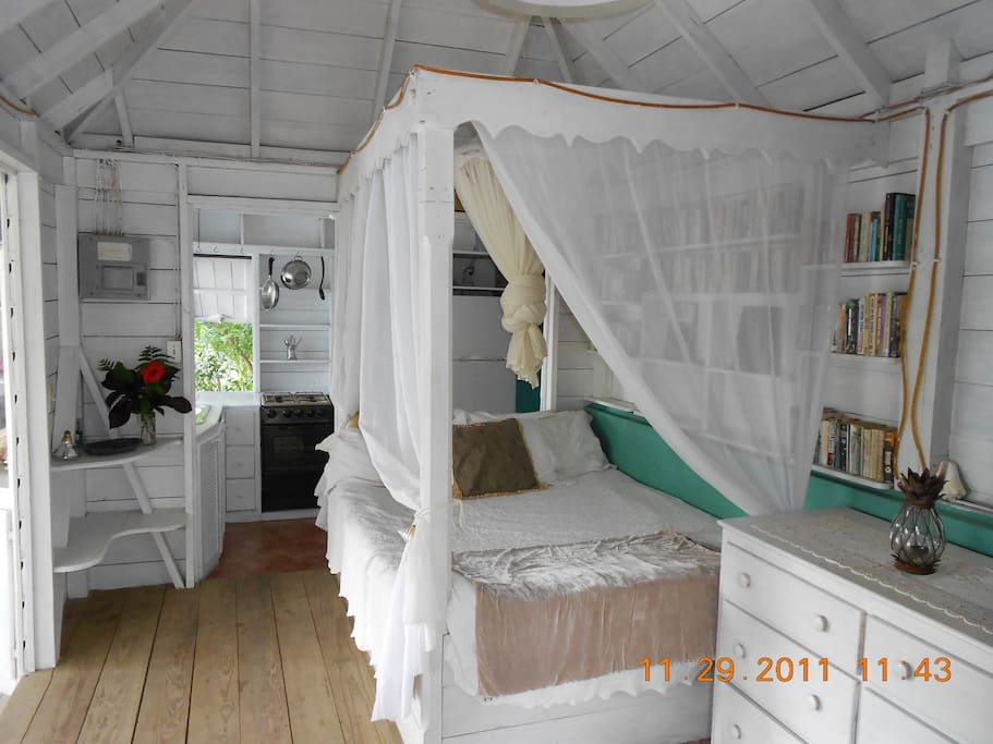 Fit for a Captain and his lady, this queen size bed is modest and quaint.  The kitchen is in the background, and the bathroom is just beyond the kitchen.