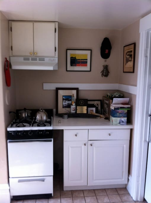 Small kitchen - equipped with Bosch washer and dryer. There is a small full stove and oven, large fridge and plently of panty space. Fully equipped.